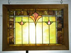 Vintage/antique architectural salvage stained glass window in wood frame