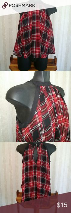 BCBG sleeveless sheer plaid high/low top Sheer sleeveless black ,red, white plaid design high low top, keyhole in back, two metal buttons to close around the neck, size small, lightly loved. BCBGeneration Tops