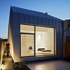 This little titanium zinc-clad house in Melbourne is by Australian Studio Architecture Gestalten.
