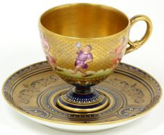 ROYAL VIENNA COBALT & GOLD PAINTED CUP & SAUCER  Antique hand painted Royal Vienna Austrian porcelain cup and saucer. Has hand painted scene depicting people dancing, playing music, and holding farming item