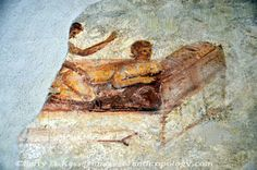 Erotic wall mural in the brothel, Pompeii, Italy. Click for larger image.