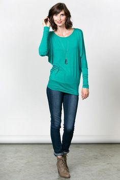 Fall in love with this Ultra Flattering Dolman which pairs perfectly with all your printed or solid leggings! This tunic is designed with a relaxed fit around the waist which becomes more fitted around the hips and dolman style sleeves that become more fitted at the forearms. Available in so many colors so you're sure to find something to match with everything in your wardrobe! Colors Available     Bright YellowCharcoalOliveWineBlackTealRoyalBrickHeather GrayLig...