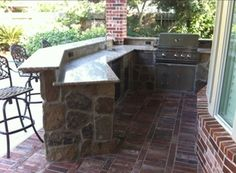 6 Outdoor Kitchens Designed To Make You Jealous: Unique Angled Counter With This Outdoor Kitchen