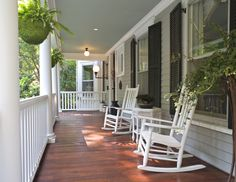 A front porch is nothing without a classic rocking chair -- or two...Try painting yours a crisp white for a look that feels fresh...
