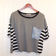 Black & White Stripped Tee With Denim Pocket Sz M Black & White Stripped Oversized Tee With Denim Pocket Women's Size M/L * In Great Preowned Condition. Minor Discoloration on Pocket. * Bundles Available at a 5% discount.  * Please see pictures & ask questions! * Sorry No Trades. Tops Tees - Short Sleeve