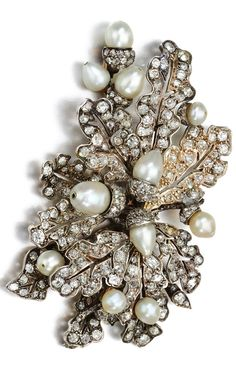 A Victorian natural pearl and diamond brooch, late 19th century. Designed as a cluster of acorn and oak leaf motifs, set with natural pearls, cushion-shaped and rose diamonds. #antique #Victorian #brooch