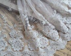 Width: 7.87 (20cm) We have the black one https://www.etsy.com/listing/245979979/2-yards-lace-trim-black-gauze-soft-lace? The material of this fabric is thin, fresh and hardness. It can be made for the wedding dress. Suitable for Skirt Bottoming,dress,scarf and a variety of handmade DIY. You will get 2 yards with this listing. Shipping Combining: I am always glad to combine shipping. If you want a faster shipping (like UPS, DHL, EMS), please feel free to contact us...