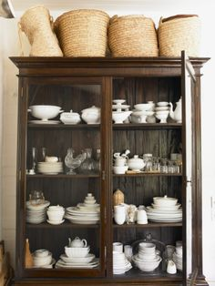 in your black hutch. Love the baskets thrown on top!