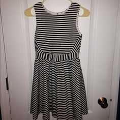 Girls Cocktail Dress Stunning GB Girls stripped dress. Size 14 in Girls! Only worn for special occasions. No stains!! Falls just above the knees! Willing to receive offers. Thanks. :) Gianni Bini Dresses Midi