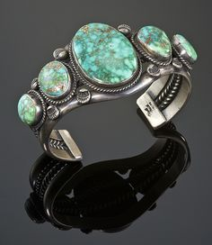 Sterling silver Carico Lake turquoise cuff bracelet by Lester Jackson
