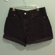 VINTAGE Levi's Black High Rise Shorts Size 36  CHEAPER THAN ETSY WILL EVER BE these are custom vintage Levi black high shorts (only custom because they were made shorts from long pants).  be aware of the sizing difference in vintage jeans from current jeans, you might have to go up one or two sizes.  Levi's Shorts Jean Shorts