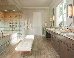 This bathroom could be your at home #spa with cozy deep #wood accents