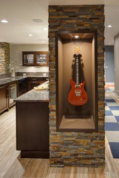 One of many custom touches, this display case for the owner's guitar is seated within one of the textured ledger stone columns. Home Design, Home Lighting Design, Home Bar Designs, Design Ideas, Interior Design, Custom Home Bars, Bars For Home, Custom Homes, Guitar Wall