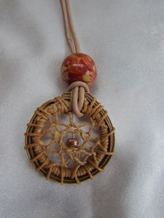 Dream Catcher Pine Needle Leather Necklace Butterscotch Wax Linen Thread Copper Seed Bead in the Center Red Wood Bead on top Ready to ship by KandApineneedlebskt on Etsy