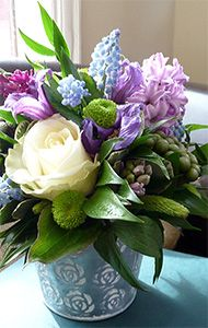 Delightful posy in a container