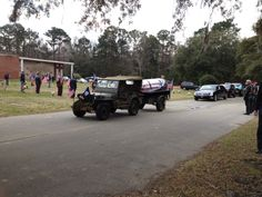 Honoring a Veteran: McAlister-Smith  jeep caisson escorted by the Patriot Guard.
