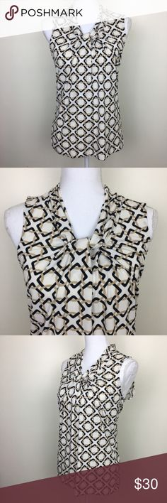 "Banana Republic Cream and Black Sleeveless Top This cream, tan, and black sleeveless top from Banana Republic features a geo, chain link print and knot at neck. Size: XS. Chest: 15.5"" - 17.5"". Length: 25"". Banana Republic Tops"