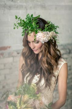 A crown of wispy greenery with a single peony |