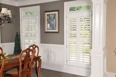 love the plantation shutters and wainscoting - wall color is nice too