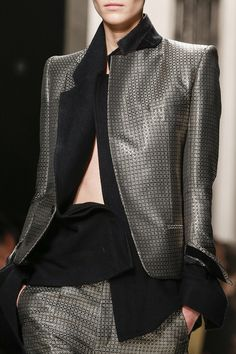 Haider Ackermann A/W 2013 - 2014. Beautiful grey/silver patterned jacket & trousers with a black top.