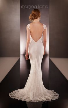 Get a look at this Martina Liana wedding dress featuring a sweetheart Lace illusion neckline, cap sleeves and cascading train made from rich Silk Moroccan with a low back.