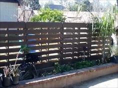 cinder block - pallet fence.  This would work for a wall to hide the trash can area. #gardenforbeginnerslandscaping