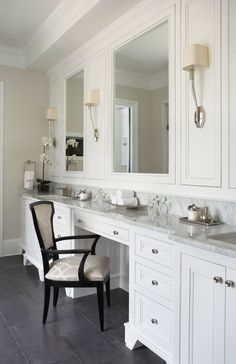 Gorgeous white bathroom with marble countertops and dark floors (Intense White)