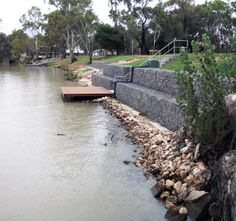 Gabion retaining wall installed by Prospect Contractors to help stabilise the river bank.