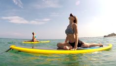 Paddle board yoga in San Diego and Oceanside. SUP yoga lessons. Learn stand up paddling take your yoga practice to the water | group classes and privates