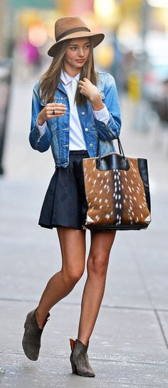 Miranda Kerr in a denim jacket and skater skirt