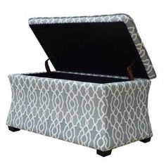 """Showcasing a hinged top and trellis-print upholstery, this versatile storage bench is perfect for stowing extra blankets in the den or outdoor accessories in your entryway.   Product: Storage benchConstruction Material: Linen and woodColor: GreyFeatures:   Hourglass shaped Hidden storage  Dimensions: 18"""" H x 32.25"""" W x 17.75"""" D"""