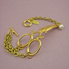 "The perfect gift for any snipping lady, hair dresser or seamstress, a scissor cuff bracelet!Brass scissors measure approximately 2 1/2"" long"