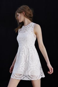 White Crochet/Lace .....(ADD Black Tights and Black Leather Jacket for