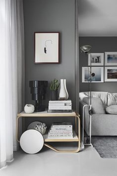 Living room with gray walls via Residence