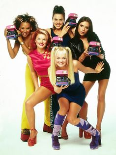 the Spice Girls with Polaroids