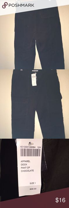 "Chico's Chocolate Brown Capri Cargo Pants These are a NWT pair of Chico's brown (chocolate) ladies capri cargo pants. Size 1 which equates to a regular size 6. Measurements when laid flat are waist 16"" and rise 11"". They retail for $58. Chico's Pants Capris"