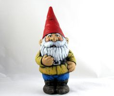 Ceramic hand painted garden gnome, medium sized (14 inches). Hand-painted with a natural matte durable weatherproof finish on the body . Assorted colours available, please specify if you have a preference (i.e. red hat or blue hat etc). Weatherproof thus perfect for lawn and garden decoration, or even inside the home if desired. Can simply be cleaned with a cloth and water (or diluted cleaner). **Dimensions: 14 inches tall  **This item is hand made from start to finish in my shop. We pour…