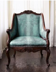 "Turquoise Chair -   Crocodile embossing and a brilliant shade of turquoise make this chair quite the stand-out. Beechwood frame from Italy has ""wormhole"" accents."