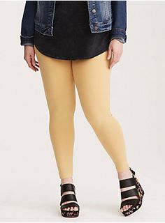 "<div>Our full length leggings in an eye-popping hue! This mustard yellow knit style has the top to bottom fit you love (tapered leg included) and is constructed with thicker fabric for when the temp drops. A new elastic waistband smooths out your tummy like never before.</div><div><ul><li style=""list-style-position: inside !important; list-style-type: disc !important"">28"" inseam</li><li style=""list-style-position: inside !important; list-style-type: disc !important"">Cotton/spandex</li><li…"