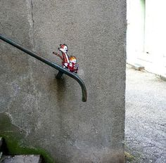 Street art :-)  Calvin and Hobbes Take off Stair railing