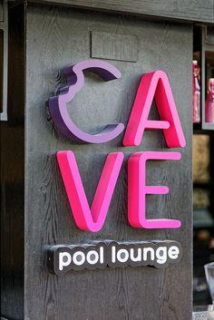 Cave Pool Lounge - Bentuk Wayfinding Signage, Signage Design, Cream Lounge, Cave Pool, Sign Board Design, Sign System, Exterior Signage, Pool Lounge, Business Signs