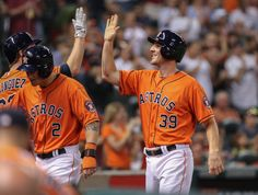CrowdCam Hot Shot: Houston Astros catcher Cody Clark is congratulated after scoring a run during the fifth inning against the Los Angeles Angels at Minute Maid Park. Photo by Troy Taormina
