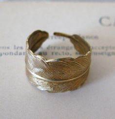 // feather ring in brass -- I have earrings exactly like this! Need this ring! :)