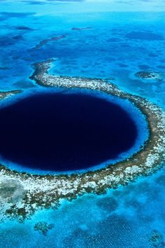 Great Blue Hole, Belize | This 1,000-foot wide hole is a sinkhole in the ocean. Geologists believe that a cave system collapsed 10,000 years ago. The dark hole descends 412 feet!