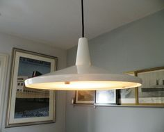I'm waiting for my marble topped Saarinen table to arrive.so I installed this Design Within Reach 'funnel' pendant (on sale). Saarinen Table, Design Within Reach, Marble Top, Mid Century, Ceiling Lights, Inspired, Lighting, Pendant, Modern