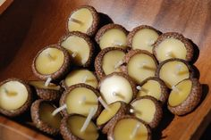 Acorn Cap Candles-- it would be cool to do this with a variety of nut shells for autumn