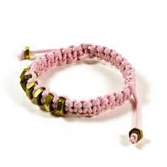 A nice macrame light pink bracelet, made of waxed cotton cord and gold brass hex nuts details.  It measures about 3/8 inches wide.  Fits most sizes.