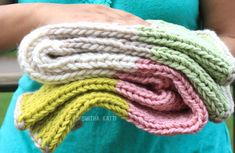 Tutorial to make a cute, cuddly, handmade baby blanket in just 10 days. Yarn stash busting projects. Handmade knit as a baby shower gift or for your family.