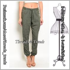 """Olive Lace Joggers Unique olive color joggers with lace front panel on legs. Drawstring elastic waist, zipper detail and 2 front pockets, made of rayon.  Small  Inseam 29"""" Waist 30"""" Rise 11"""" Hips 40"""" Medium Inseam 29"""" Waist 32"""" Rise 11"""" Hips 42"""" Large Inseam 29"""" Waist 34"""" Rise 12"""" Hips 46"""" Threads & Trends Pants Track Pants & Joggers"""