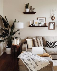 *end table & plant at side of couch*